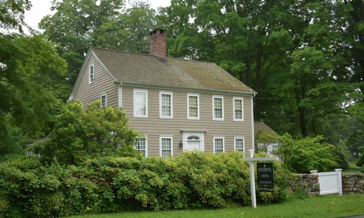 An Umpawaug Road home in Redding, Conn. dating back to 1820, on the market as of early July 2021 for just under $1 million.