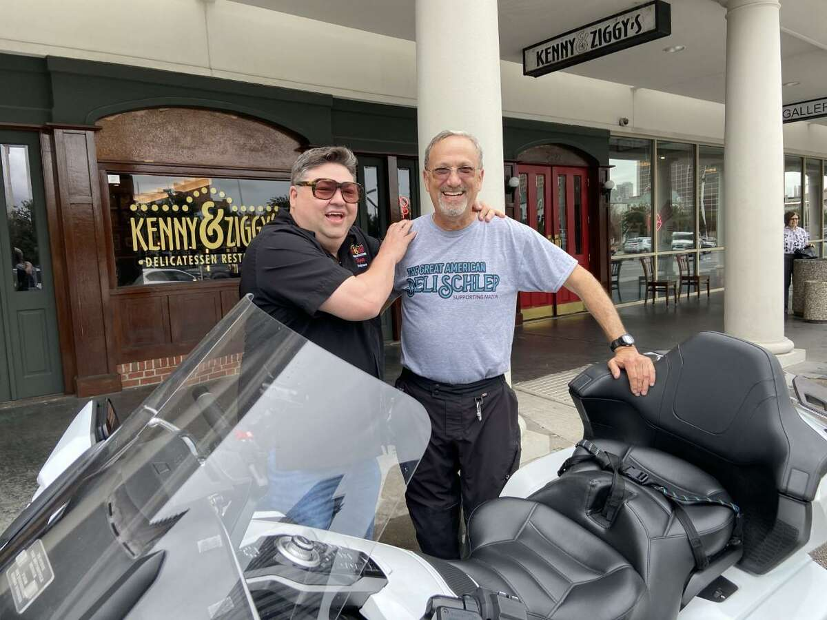 Steve Goode (right) who stopped by Kenny & Ziggy's Delicatessen on July 8 as part of his cross-country motorcycle tour, The Great American Deli Schlep, with his 2018 Honda Gold Wing motorcycle and Kenny & ZIggy's owner Ziggy Gruber (left)