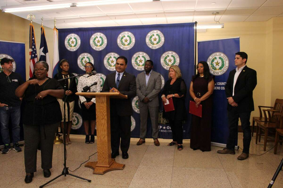 Fort Bend County Judge KP George speaks during a news conference touting the county's support of small businesses.