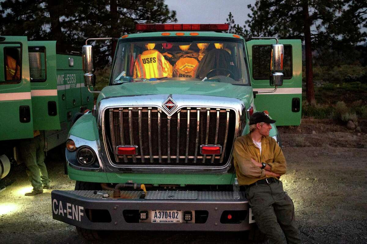 A U.S. Forest Service firefighter prepares to work an overnight shift while battling the Lava Fire in Weed (Siskiyou County).