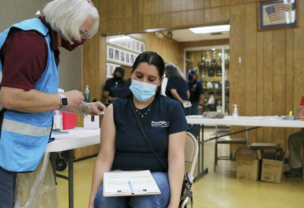 Leishla Martinez gets a COVID-19 vaccine at a pop-up clinic on the city's Southwest Side in April. The shot is painless, a reader says, asking to see fewer photos of wincing faces.