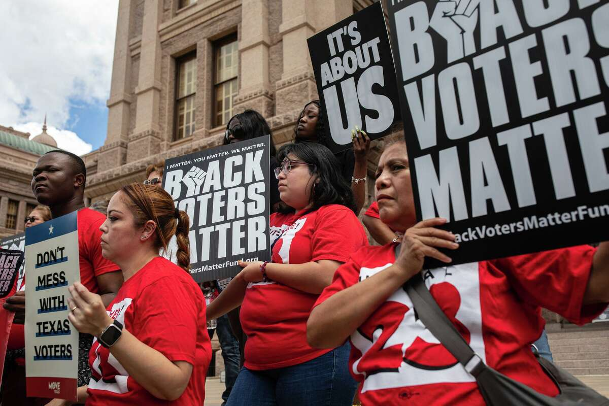 Demonstrators rally against voter restrictions on the first day of the special session. If discriminatory voting practices were upheld in Arizona, they could be upheld in Texas, too.