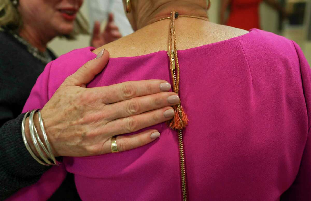 Tracey Brown, executive director of Amazing Place, comforts an Alzheimer's patient.