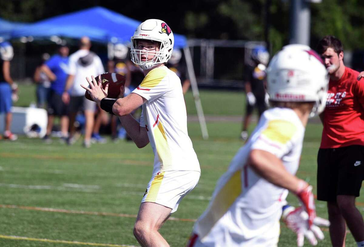 Greenwich quarterback Jack Wilson eyes a receiver downfield during the first day of the Grip It and Rip It football tournament in New Canaan on Friday.