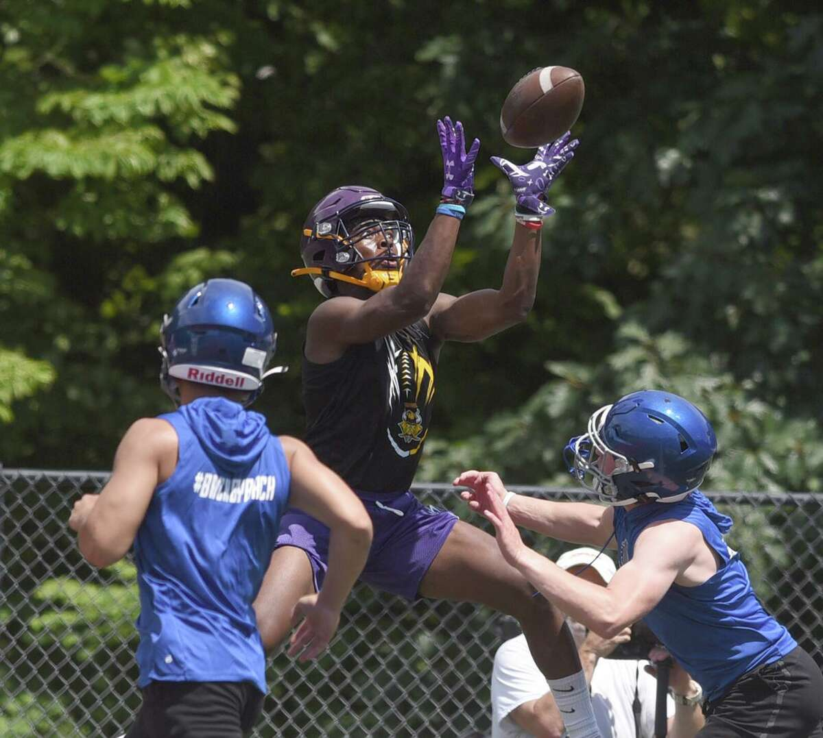 Westhill's David Moody goes up to catch a pass during day one of the Grip It and Rip It football tournament in New Canaan on Friday, July 9, 2021.