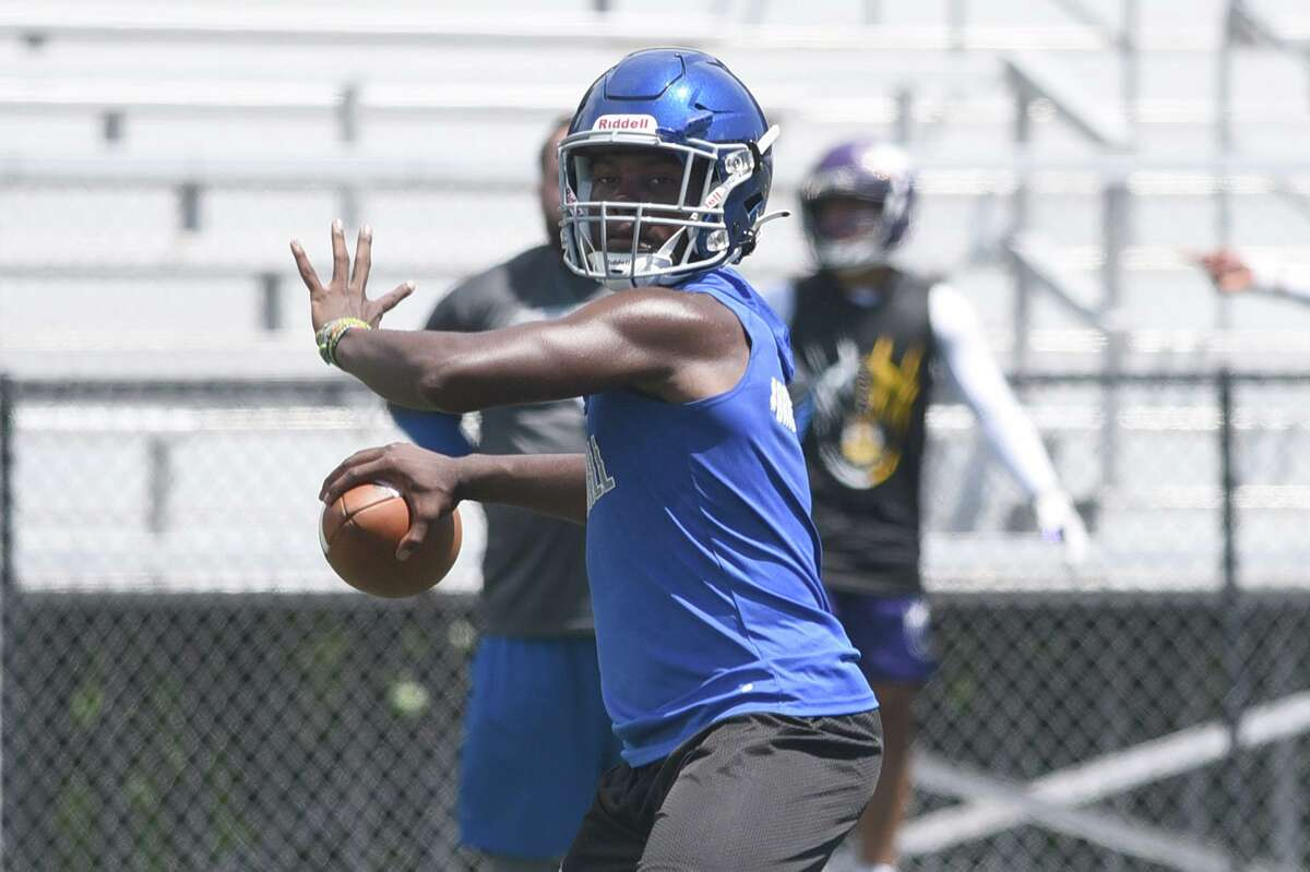 Bunnell quarterback Theodore Lanham III gets ready to throw a pass downfield during day one of the Grip It and Rip It football tournament in New Canaan on Friday, Jule 9, 2021.