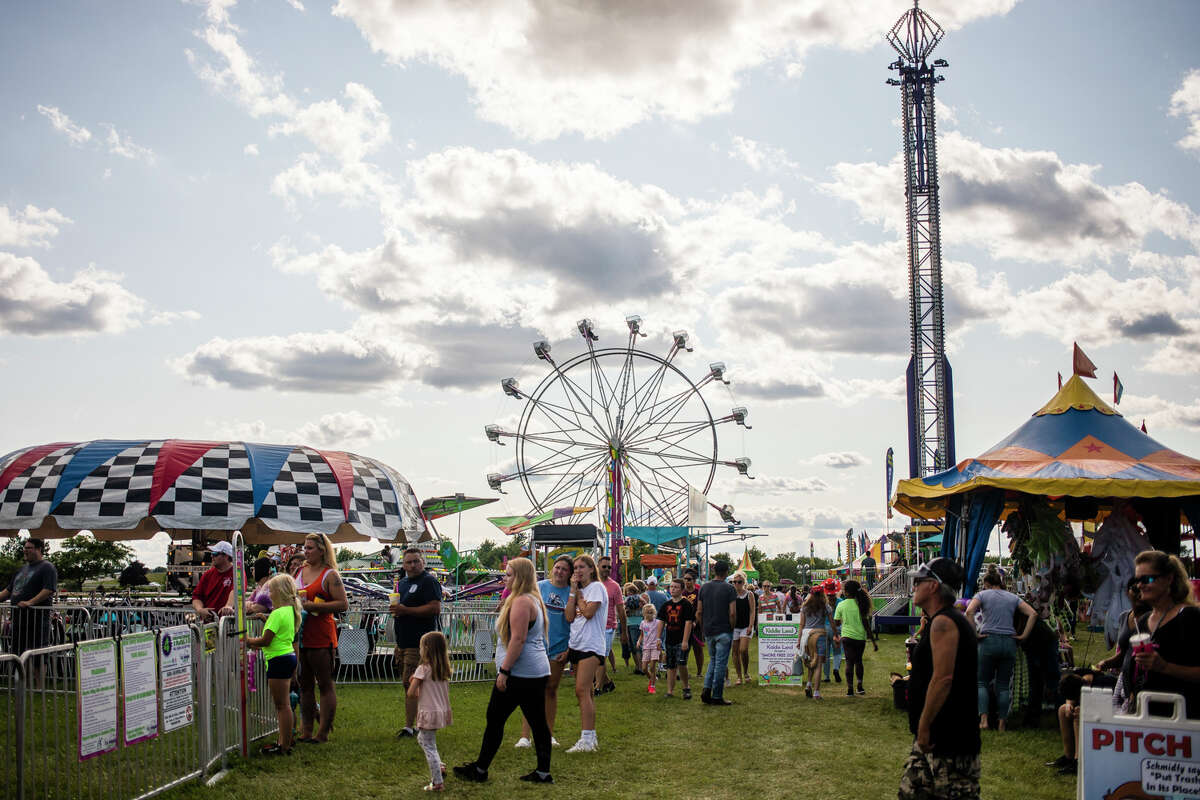 Hundreds of people enjoy games, snacks and rides at a carnival during the Auburn Cornfest Friday, July 9, 2021 in Auburn. (Katy Kildee/kkildee@mdn.net)