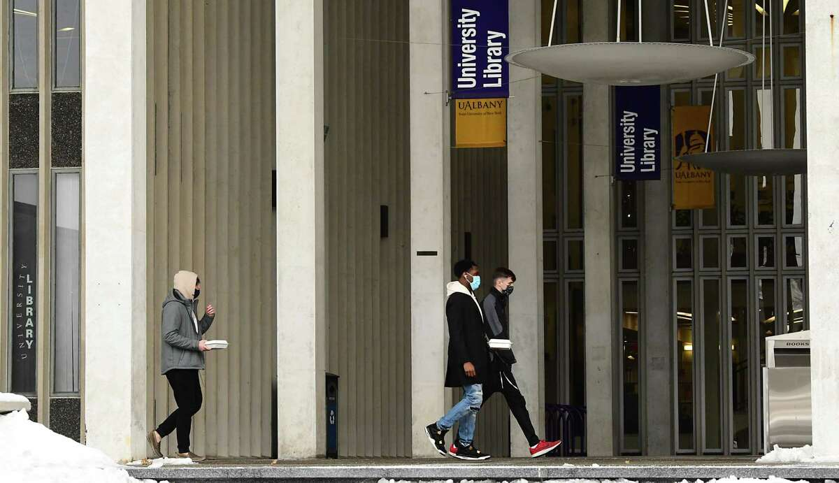 Students are seen walking on campus as classes resume at University at Albany Monday, Feb. 1, 2021 in Albany, N.Y. (Lori Van Buren/Times Union)