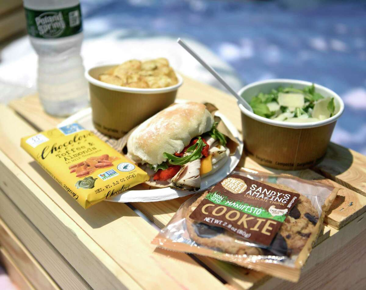 """The """"American Picnic"""" grab-and-go picnic basket at The Snackbox in Mill River Park in Stamford, Conn. Wednesday, July 7, 2021. Mill River Park released its summer programming schedule and seasonal changes, including a new grab and go picnic basket for kids, adults and couples."""
