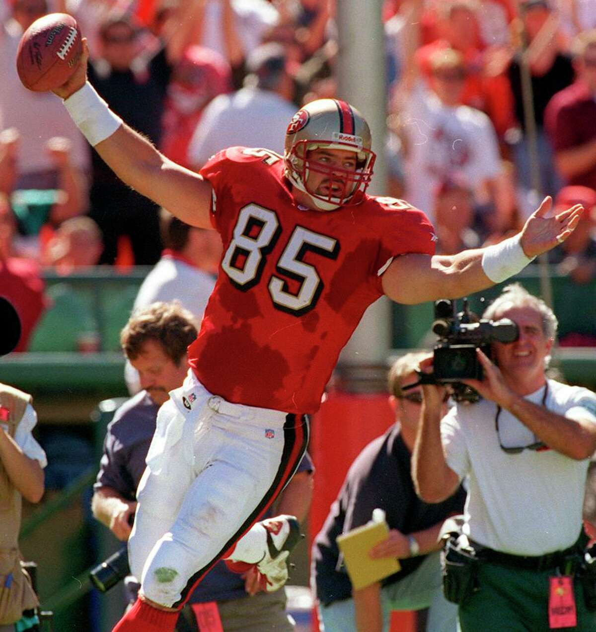 49ers tight end Greg Clark scores his first pro touchdown in the first quarter against the Rams in 1997.