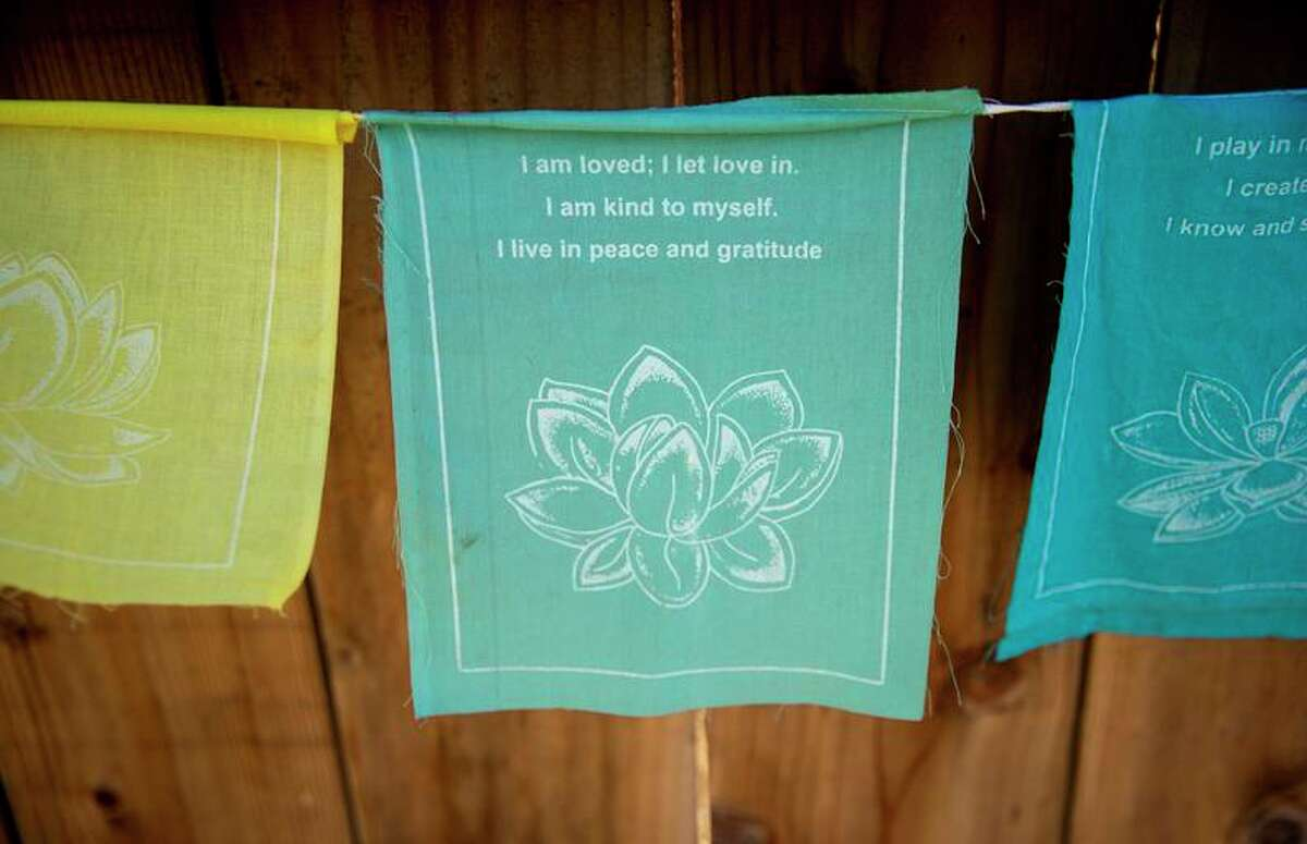 Inspirational messages hang on the wall of the Long Live Love foundation's healing garden in Oakland.