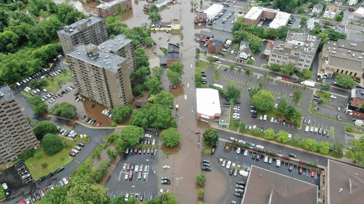 MERIDEN, Conn. - Photos captured by a drone show the extent of flooding in the wake of Tropical Storm Elsa Friday, June 9, 2021. Police asked people to avoid the downtown area while emergency crews worked.