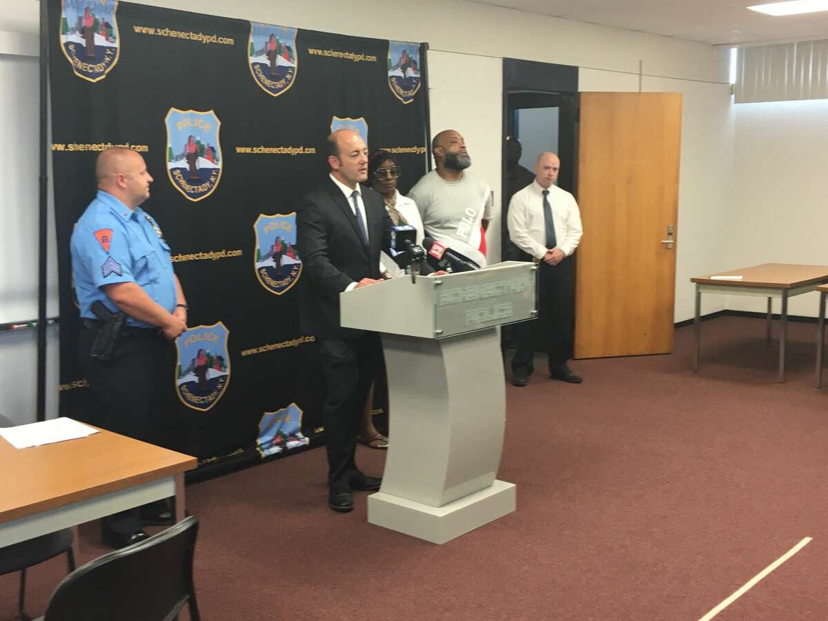 Schenectady police officials and family members of July 2020 shooting victim Ieasha Merritt attend a press conference Friday July 9, 2021
