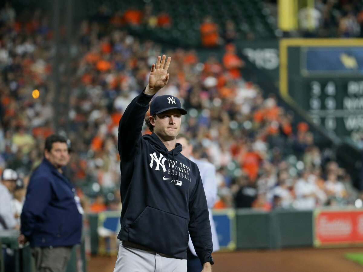 New York Yankees starting pitcher Gerrit Cole (45) waves to Houston Astros fans after a video tribute was played in his honor before the start of an MLB game at Minute Maid Park on Friday, July 9, 2021, in Houston.