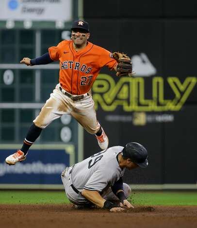 Houston Astros second baseman Jose Altuve (27) turns a double play against the New York Yankees during the seventh inning of an MLB game at Minute Maid Park on Friday, July 9, 2021, in Houston. Photo: Godofredo A Vásquez/Staff Photographer / © 2021 Houston Chronicle