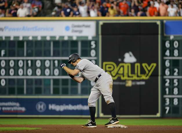 New York Yankees first baseman DJ LeMahieu (26) celebrates at second base after hitting a two-RBI double against the Houston Astros during the seventh inning of an MLB game at Minute Maid Park on Friday, July 9, 2021, in Houston. Photo: Godofredo A Vásquez/Staff Photographer / © 2021 Houston Chronicle