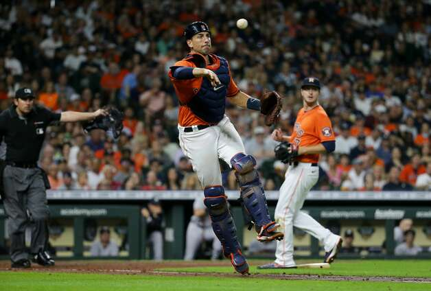 Houston Astros catcher Jason Castro (18) throws a ball to first base for an out against the New York Yankees during the sixth inning of an MLB game at Minute Maid Park on Friday, July 9, 2021, in Houston. Photo: Godofredo A Vásquez/Staff Photographer / © 2021 Houston Chronicle