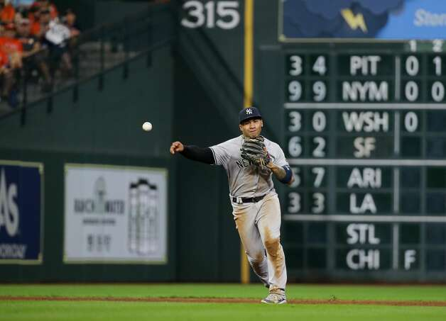 New York Yankees shortstop Gleyber Torres (25) throws to first base for an out against the Houston Astros during the sixth inning of an MLB game at Minute Maid Park on Friday, July 9, 2021, in Houston. Photo: Godofredo A Vásquez/Staff Photographer / © 2021 Houston Chronicle