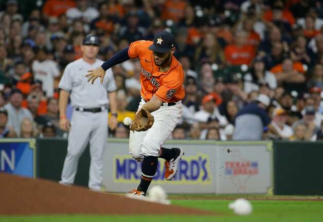Houston Astros third baseman Abraham Toro (13) scoops up a ball before throwing to first base for an out against the New York Yankees during the seventh inning of an MLB game at Minute Maid Park on Friday, July 9, 2021, in Houston. Photo: Godofredo A Vásquez/Staff Photographer / © 2021 Houston Chronicle