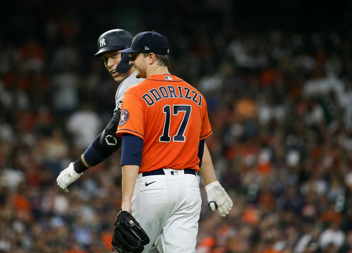 New York Yankees right fielder Aaron Judge (99) talks with Houston Astros starting pitcher Jake Odorizzi (17) after hitting a fly out to right field during the fifth inning of an MLB game at Minute Maid Park on Friday, July 9, 2021, in Houston.
