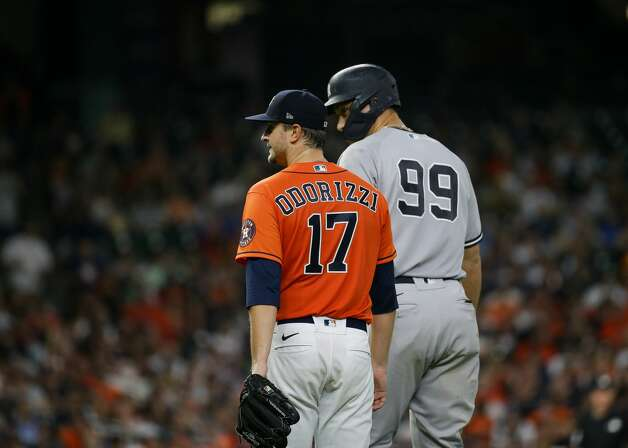 New York Yankees right fielder Aaron Judge (99) talks with Houston Astros starting pitcher Jake Odorizzi (17) after hitting a fly out to right field during the fifth inning of an MLB game at Minute Maid Park on Friday, July 9, 2021, in Houston. Photo: Godofredo A Vásquez/Staff Photographer / © 2021 Houston Chronicle