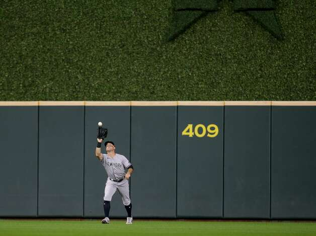 New York Yankees center fielder Brett Gardner (11) catches a ball for an out against the Houston Astros during the fourth inning of an MLB game at Minute Maid Park on Friday, July 9, 2021, in Houston. Photo: Godofredo A Vásquez/Staff Photographer / © 2021 Houston Chronicle
