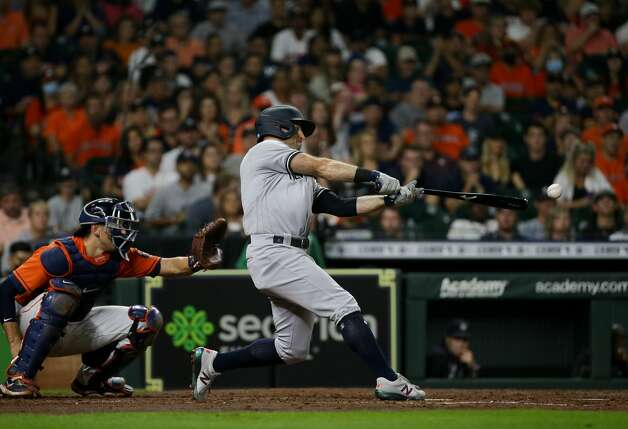 New York Yankees center fielder Brett Gardner (11) hits a two-RBI double to right field against the Houston Astros during the fourth inning of an MLB game at Minute Maid Park on Friday, July 9, 2021, in Houston. Photo: Godofredo A Vásquez/Staff Photographer / © 2021 Houston Chronicle