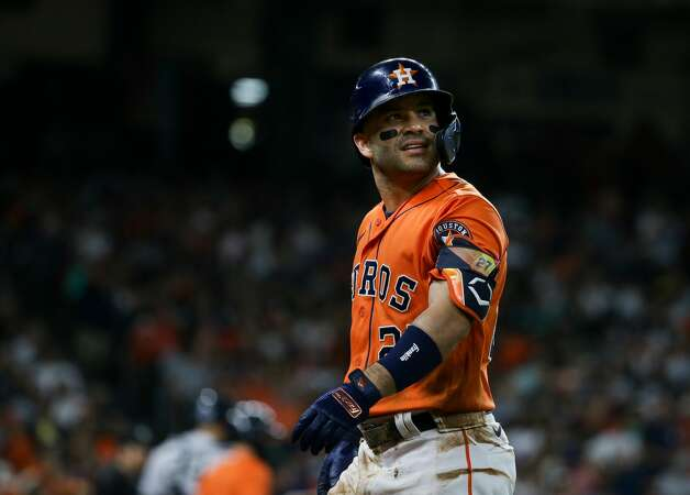 Houston Astros second baseman Jose Altuve (27) walks back to the dugout after hitting a fly out to center field against the New York Yankees during the third inning of an MLB game at Minute Maid Park on Friday, July 9, 2021, in Houston. Photo: Godofredo A Vásquez/Staff Photographer / © 2021 Houston Chronicle