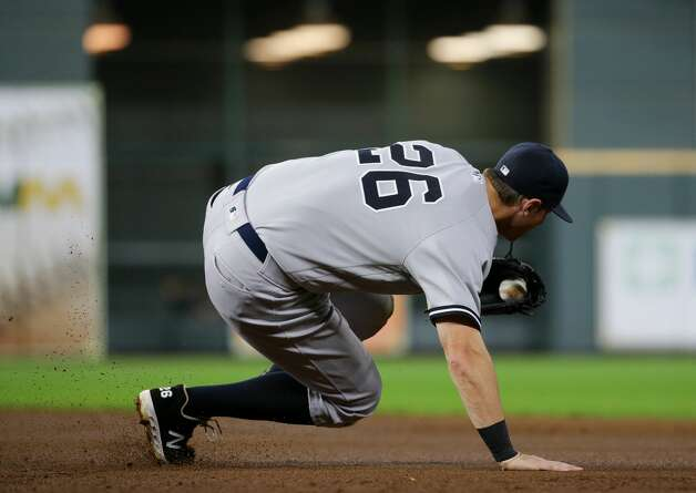 New York Yankees first baseman DJ LeMahieu (26) corals a ball before racing to first base for a force out against the Houston Astros during the third inning of an MLB game at Minute Maid Park on Friday, July 9, 2021, in Houston. Photo: Godofredo A Vásquez/Staff Photographer / © 2021 Houston Chronicle