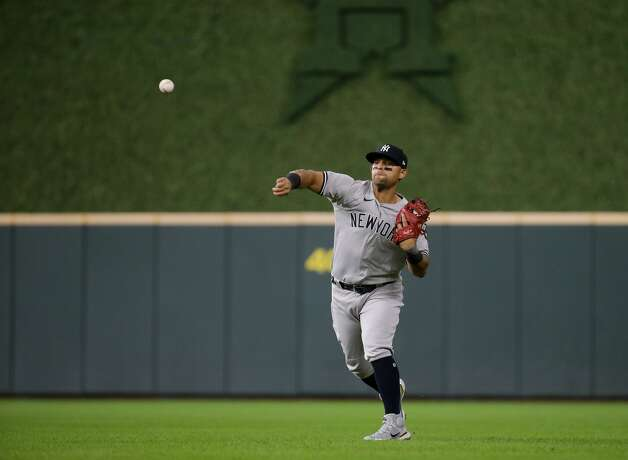 New York Yankees second baseman Rougned Odor (18) throws to first base for an out against the Houston Astros during the second inning of an MLB game at Minute Maid Park on Friday, July 9, 2021, in Houston. Photo: Godofredo A Vásquez/Staff Photographer / © 2021 Houston Chronicle