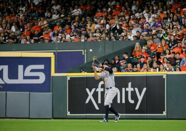 New York Yankees right fielder Aaron Judge (99) catches a ball for an out against the Houston Astros during the second inning of an MLB game at Minute Maid Park on Friday, July 9, 2021, in Houston. Photo: Godofredo A Vásquez/Staff Photographer / © 2021 Houston Chronicle