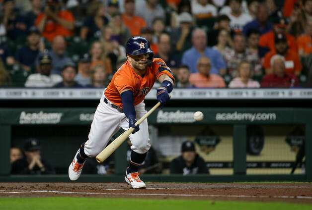 Houston Astros second baseman Jose Altuve (27) bunts a ball against the New York Yankees during the first inning of an MLB game at Minute Maid Park on Friday, July 9, 2021, in Houston. Photo: Godofredo A Vásquez/Staff Photographer / © 2021 Houston Chronicle