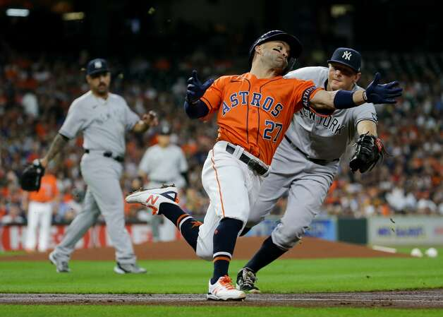 Houston Astros second baseman Jose Altuve (27) unsuccessfully tries to avoid the tag by New York Yankees first baseman DJ LeMahieu (26) during the first inning of an MLB game at Minute Maid Park on Friday, July 9, 2021, in Houston. Photo: Godofredo A Vásquez/Staff Photographer / © 2021 Houston Chronicle
