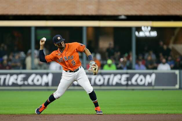Houston Astros shortstop Robel Garcia (9) throws to first base for an out against the New York Yankees during the first inning of an MLB game at Minute Maid Park on Friday, July 9, 2021, in Houston. Photo: Godofredo A Vásquez/Staff Photographer / © 2021 Houston Chronicle