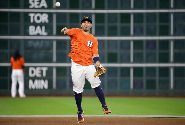 Houston Astros second baseman Jose Altuve (27) throws to first base while fielding a ground ball during warmup, before an MLB game against the New York Yankees at Minute Maid Park on Friday, July 9, 2021, in Houston. Photo: Godofredo A Vásquez/Staff Photographer / © 2021 Houston Chronicle