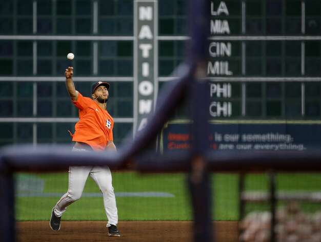 Houston Astros third baseman Abraham Toro (13) throws to first base while fielding a ground ball during warmup, before an MLB game against the New York Yankees at Minute Maid Park on Friday, July 9, 2021, in Houston. Photo: Godofredo A Vásquez/Staff Photographer / © 2021 Houston Chronicle