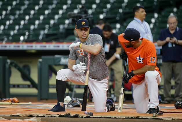 Houston Astros infielder Aledmys Diaz (16) talks with third baseman Abraham Toro (13) during batting practice, before an MLB game against the New York Yankees at Minute Maid Park on Friday, July 9, 2021, in Houston. Photo: Godofredo A Vásquez/Staff Photographer / © 2021 Houston Chronicle