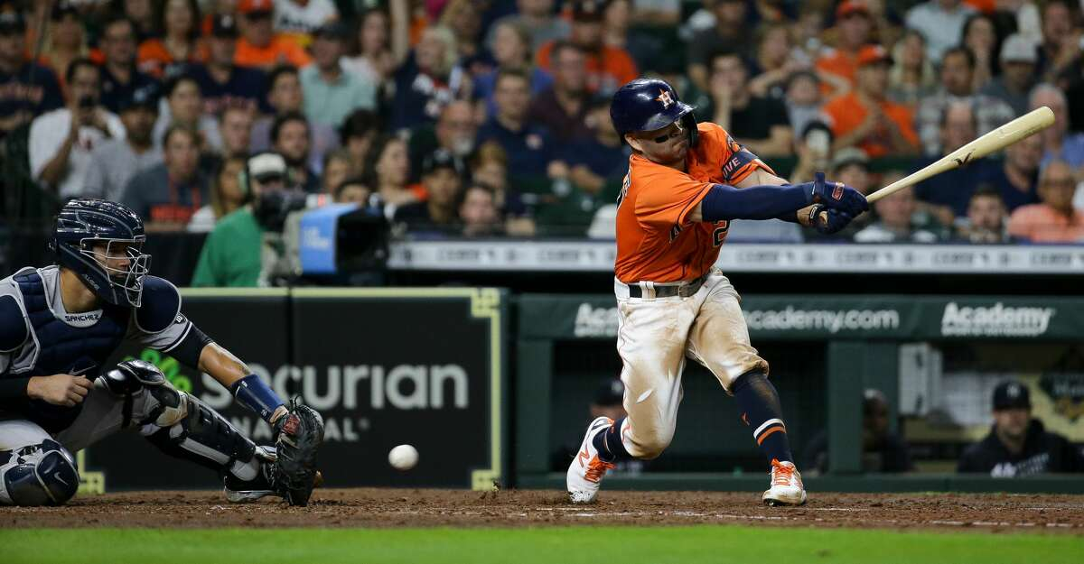 Houston Astros second baseman Jose Altuve (27) strikes out swinging against the New York Yankees during the fifth inning of an MLB game at Minute Maid Park on Friday, July 9, 2021, in Houston.