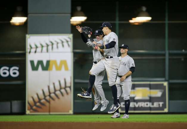 New York Yankees left fielder Tyler Wade (14) and right fielder Aaron Judge (99) celebrate after defeating the Houston Astros 4-0 at Minute Maid Park on Friday, July 9, 2021, in Houston. Photo: Godofredo A Vásquez/Staff Photographer / © 2021 Houston Chronicle