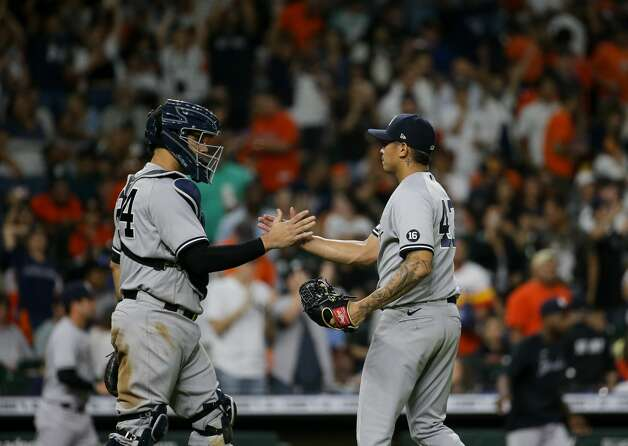 New York Yankees starting pitcher Jonathan Loaisiga (43) and catcher Gary Sanchez (24) celebrate after their 4-0 win against the Houston Astros at Minute Maid Park on Friday, July 9, 2021, in Houston. Photo: Godofredo A Vásquez/Staff Photographer / © 2021 Houston Chronicle