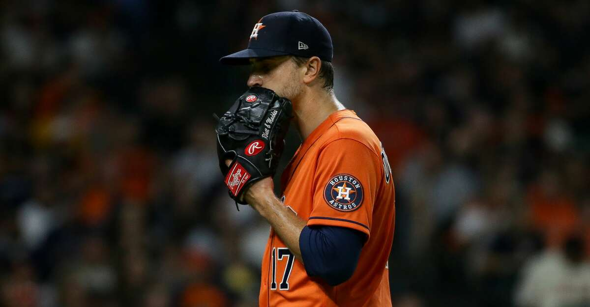 Houston Astros starting pitcher Jake Odorizzi (17) walks to the dugout after pitching a scoreless third inning during an MLB game against the New York Yankees at Minute Maid Park on Friday, July 9, 2021, in Houston.