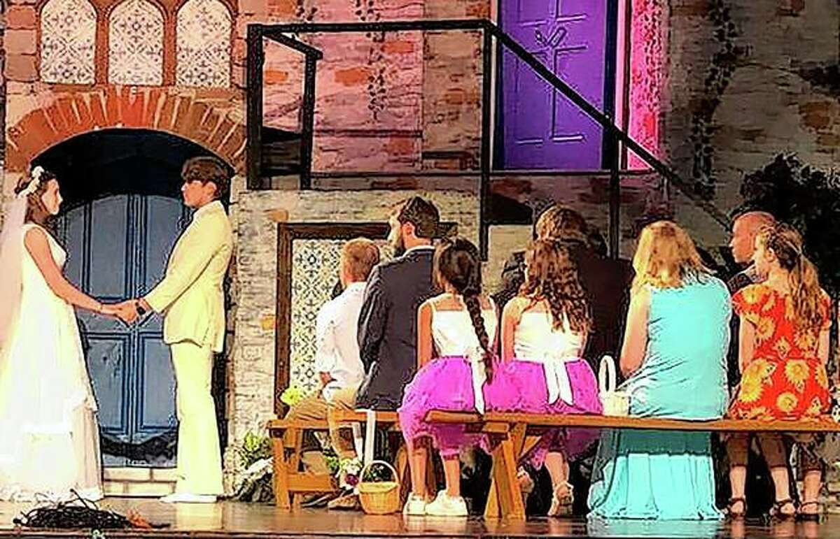 """Members of the cast of the Beardstown Grand Opera House production of """"Mamma Mia!"""" rehearse a scene. The play opens Friday."""