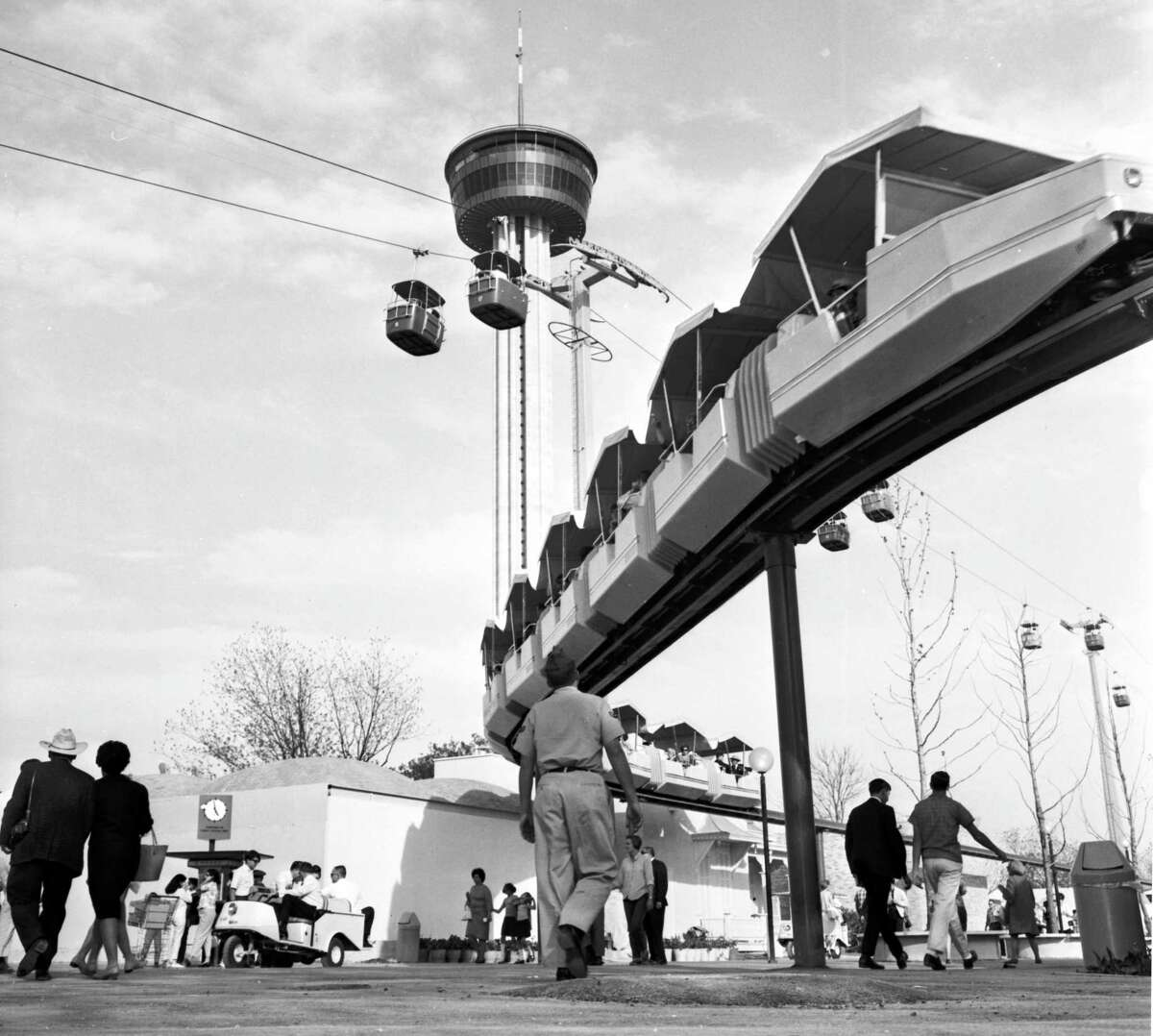 """The Tower of Americas is shown behind the monorail during HemisFair 1968. A celebrity competition called """"the world's tallest milking contest"""" was held at the top of the 575-foot tower, according to a news report of the time."""
