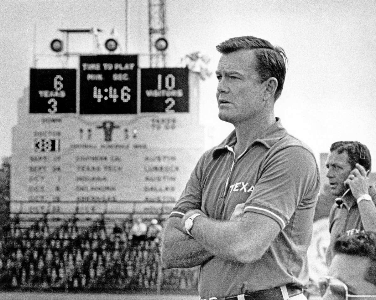University of Texas Longhorns football coach Darrell Royal competed in the Tower of the Americas summit milking competition during HemisFair '68.