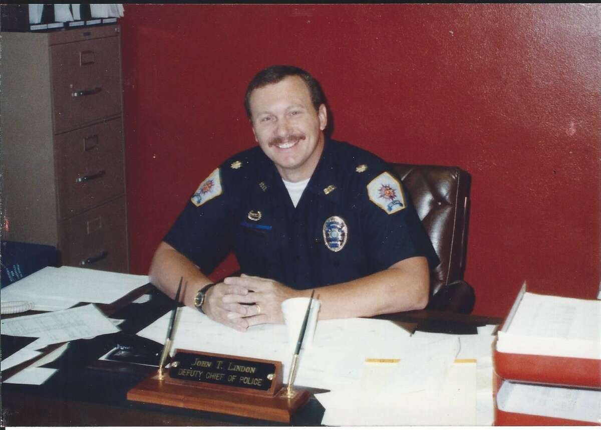 Conroe Police Department Deputy Chief John T. Lindon is seen at his office desk in 1989.