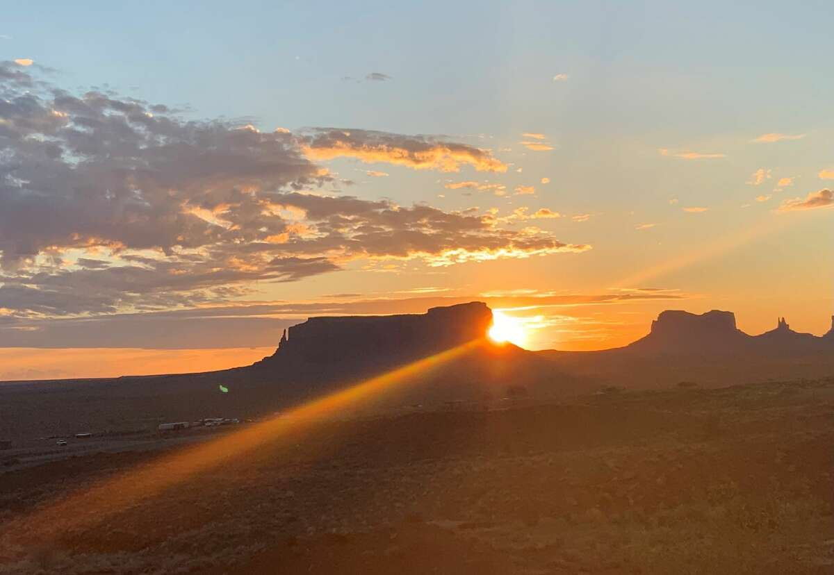 The sun was beginning to light the sky in Monument Valley on the Navajo Reservation at 6:14 a.m. on June 26, 2021. Photo taken from Goulding's Lodge in this image from Jo Anne Assini of Niskayuna.