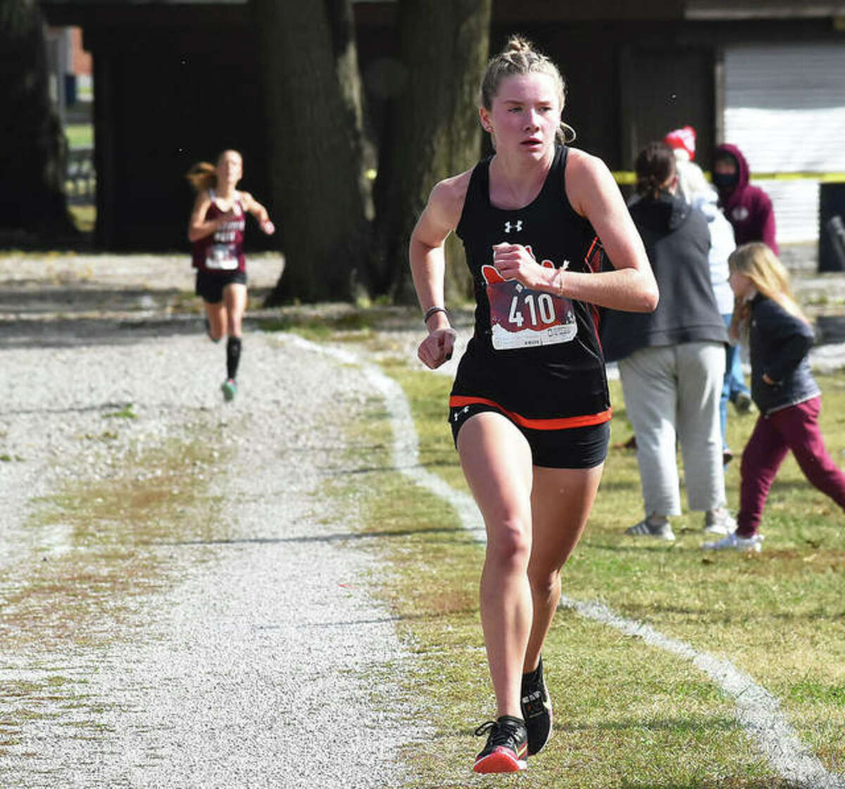 Edwardsville sophomore Riley Knoyle (front) runs alone in third place at the Granite City Class 3A Regional at Wilson Park. Knoyle is the 2020 Telegraph Large-Schools Girls Cross Country Runner of the Year, repeating the honor she was as a freshman.