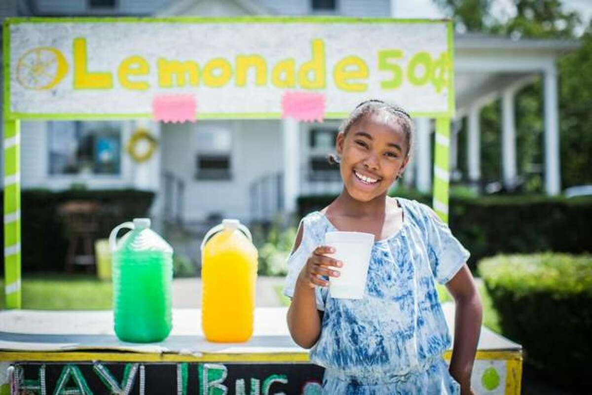 Hayli Martenez is shown at her lemonade stand in Kankakee. On Friday Gov. J.B. Pritzker signed Senate Bill 119 allowing a lemonade stand to be operated by a person under 16 without regulation and without having to get a food permit from local public health officials.