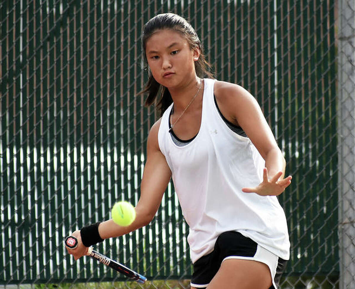 Edwardsville's Chloe Koons focuses on a shot during a home match last season at the EHS Tennis Center.
