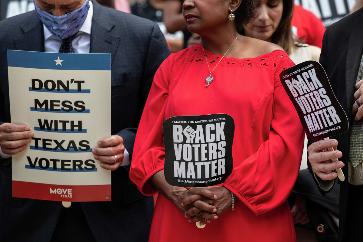 Members of the Texas House Democratic Caucus take part in a voting rights rally outside of the Texas State Capitol on the first day of the 87th Legislature's special session on July 8, 2021 in Austin, Texas.